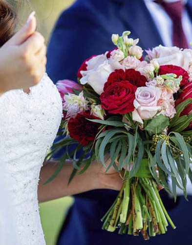 Wedding bouquet dusty pink and red with natives